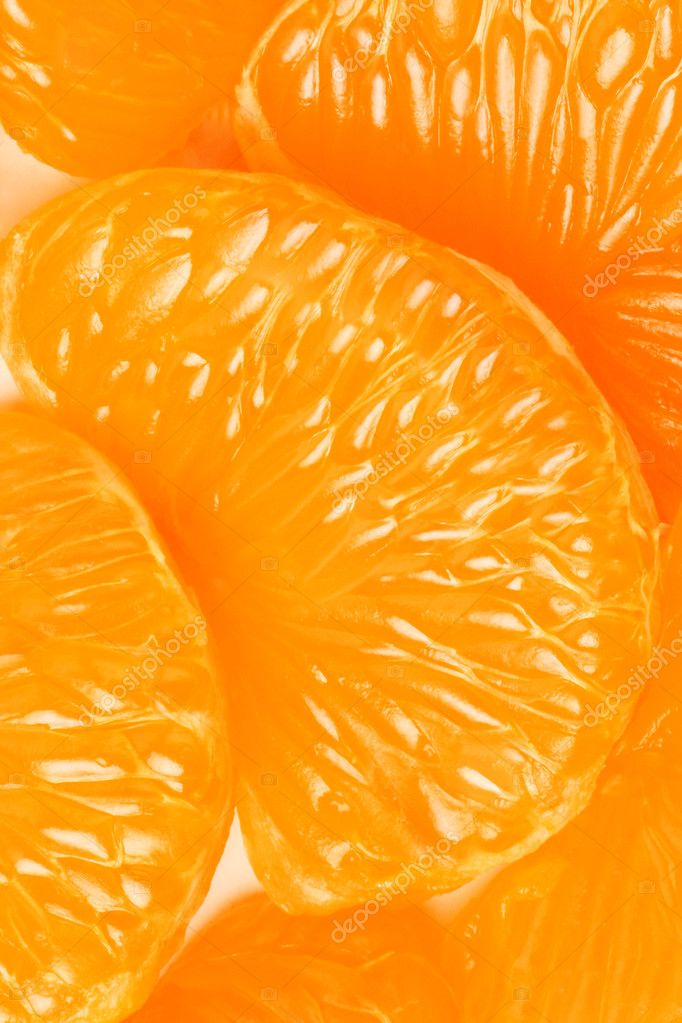 Mandarin slice. Peeled tangerine slices orange background — Stock Photo #9208193