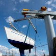 Sailboat lift up by boat lifter — Stockfoto #10249362