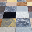 Display of different stone granite floor tiles — Stock Photo
