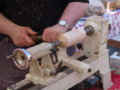Wood turning craft on a lathe — Stock Photo