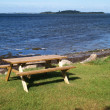 Outdoors Picnic table by the beach — Photo
