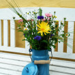 Beautiful spring summer flowers in tin bucket vertical image — Stock Photo