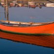 Reflection of a small dinghy dory boat — Stock Photo