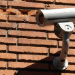 Security surveillance camera - Stock Photo
