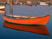 Reflection of a small dinghy dory boat — Foto Stock