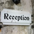 Reception sign in an old hotel — Stock Photo