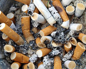 Background Ashtray full of Cigarette Butts — Stock Photo