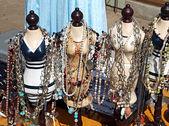 Antique jewelery items on figurines — Stock Photo