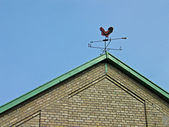 Weathercock vane on a roof — Stock Photo
