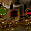 Stock Photo: Beer taps in pub bar