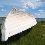 Beach landscape -Fishermen Skiff boat on the sand — Stock Photo #8976544
