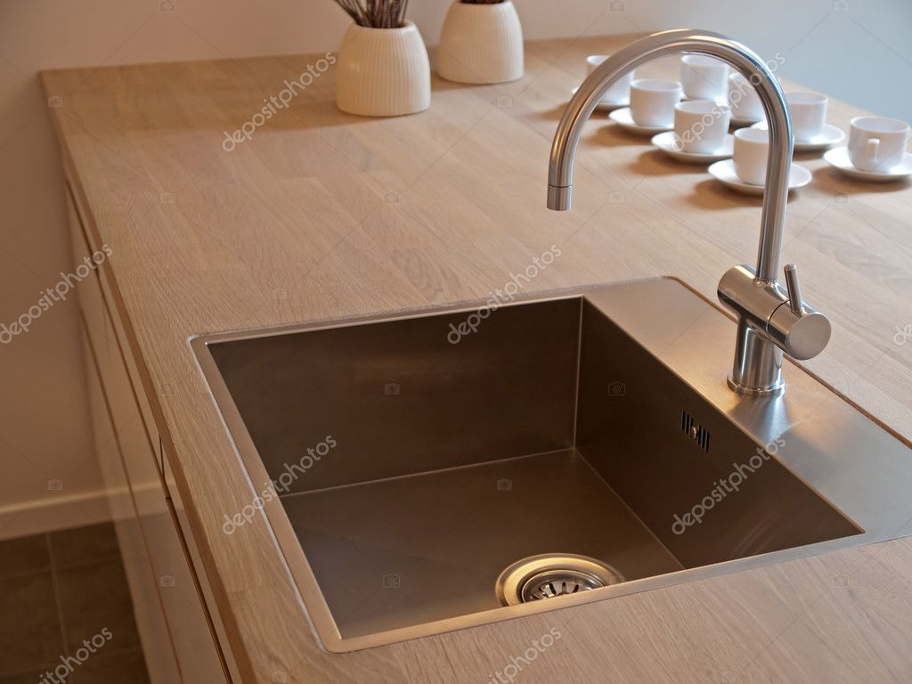 Details of modern design trendy  kitchen sink with water tap faucet — Stock Photo #8976238