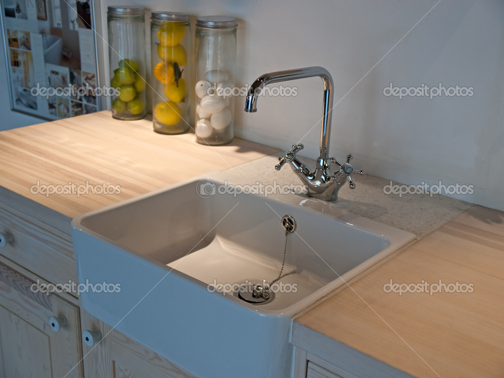 Details of modern classical design trendy  kitchen sink with water tap faucet  Stock Photo #8976242