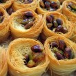Baklawa Oriental Arab sweets - freshly baked - Stock Photo