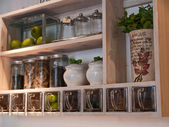 Beautiful classical kitchen shelves and spices rack — Stock Photo