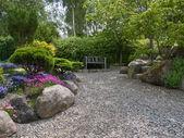Beautiful garden romantic seating corner — Stock Photo