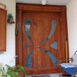 Beautiful decorative hand carved wooden glass door — Stockfoto #9012531