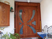 Beautiful decorative hand carved wooden glass door — Stock Photo