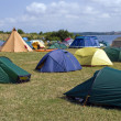 Photo: City of colorful tents by beach
