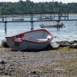 Small fishing boat dory rowboat on the shore — Stock Photo #9120558
