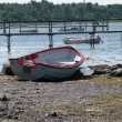 Small fishing boat dory rowboat on the shore — Stock fotografie