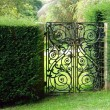 Black wrought iron garden gate — Stock Photo