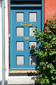 Bright colors traditional painted wooden door — Stock Photo