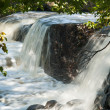 Beautiful cascading waterfall over rocks — Stock Photo