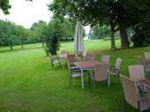 Charming backyard garden seating corner — Stock Photo