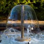 Decorative garden water fountain — Stock Photo