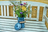 Beautiful spring summer flowers in tin bucket digital art manipu — Stockfoto