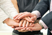 Business team with their hands together — Stock Photo