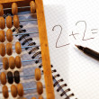 Old abacus and maths operation — Stock Photo
