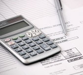 Payroll calculator — Stock Photo