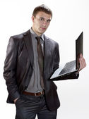 Young Businessman Holding laptop — Stock Photo