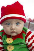 Baby at christmas with present — Stock Photo