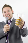 Happy Karaoke Singing Businessman — Stock Photo