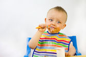 Messy Faced Infant Eating — Stock Photo