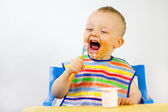 Messy Babies Food Round Face — Stock Photo