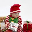 Stock Photo: Babys lonely first christmas