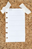 Notepad page on cork board — Stock Photo
