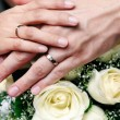 Stock Photo: Hands of newlywed couple