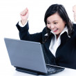 Successful businesswomcheering in front of laptop — Stock Photo #8523173