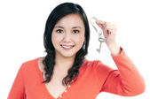 Attractive young woman holding a key — Stock Photo