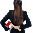 Businesswoman holding axe behind her back — Stockfoto