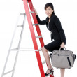 Attractive businesswoman climbing up ladder — Stock Photo