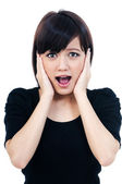 Young Asian Woman looking Surprised — Stock Photo
