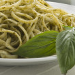 Pasta with basil - Stock Photo