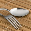 Rice spoon and fork and white flower — Stock Photo