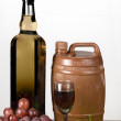 Barrel with a glass of red wine on white background - Stock Photo